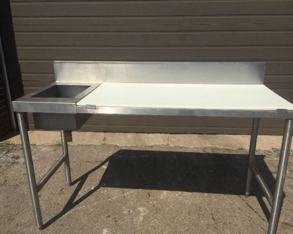 stainless steel table with sink and cutting board